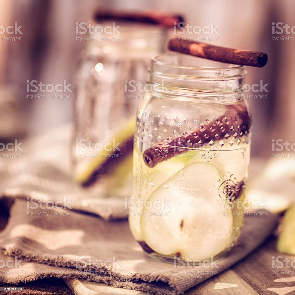 Infused Water with Fresh Pears and Cinnamon stock photo