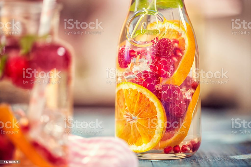 Infused Water with Fresh Raspberries, Lemon, Pomegranate and Mint stock photo