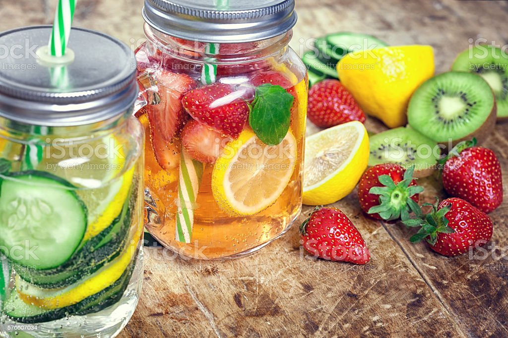 Infused Water with Fresh Strawberries, Lemon, Cucumber, Kiwi and Mint stock photo
