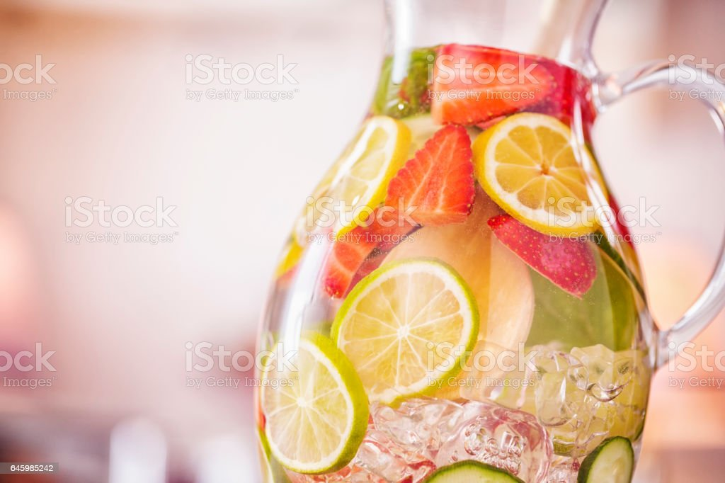 Infused Water with Fresh Strawberries, Lime, Lemon and Basil stock photo