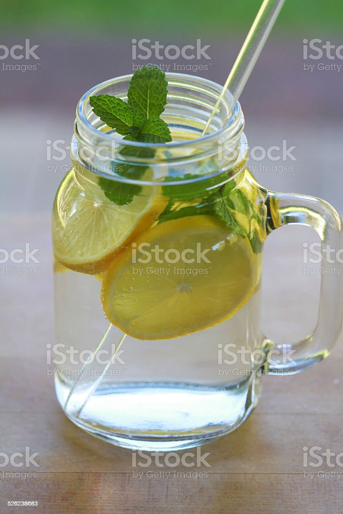 infused water with lemon and mint stock photo