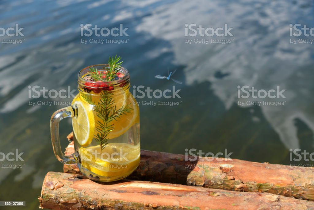 Infused water with wild strawberries lemon and blueberries stock photo