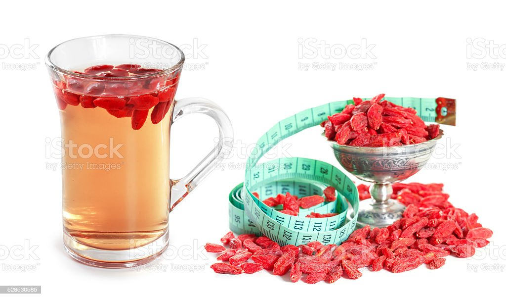 Infusion of goji berries with dry berries stock photo
