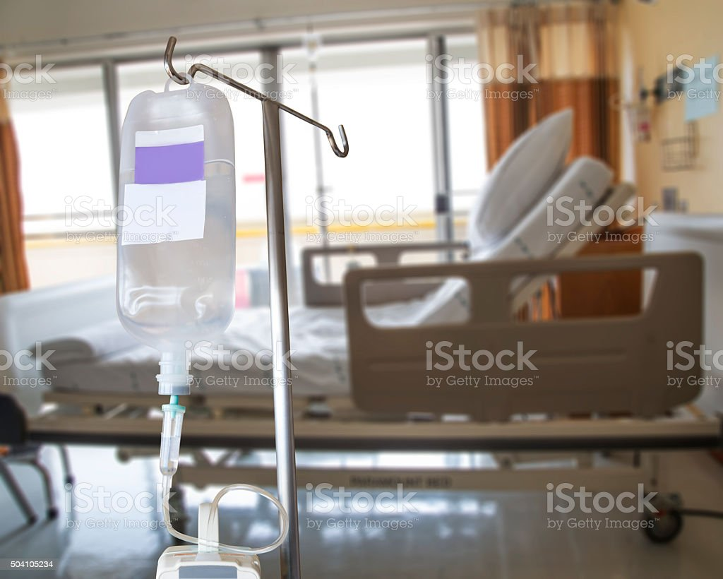 Infusion pump and IV hanging on pole in hospital stock photo