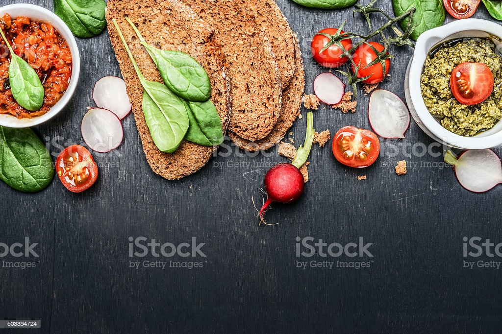 Ingredients and spread for vegetarian sandwich making , top view, border stock photo