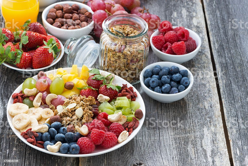 ingredients for a healthy breakfast - berries, fruit, muesli stock photo
