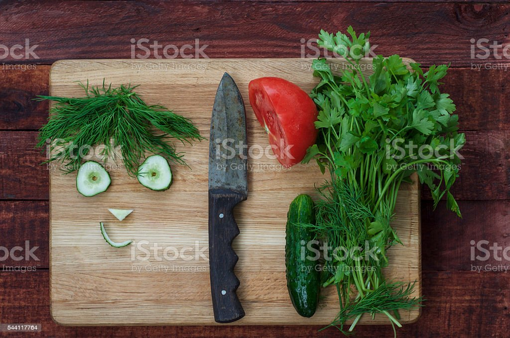 ingredients for a healthy salad: tomatoes, cucumbers and herbs stock photo