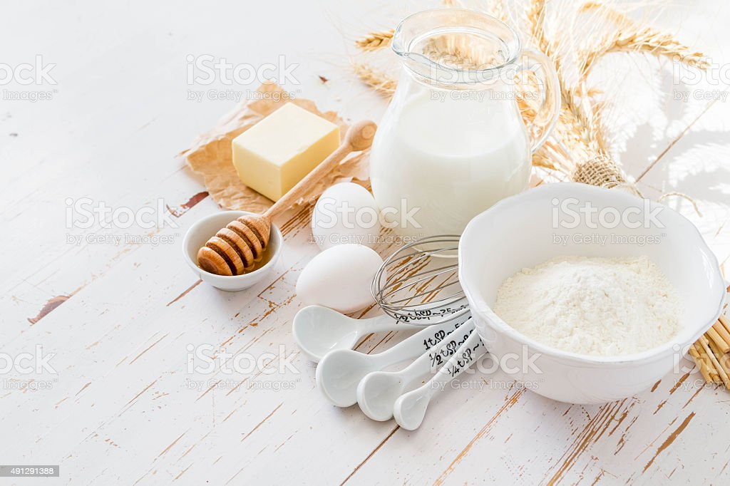 Ingredients for baking - milk, butter, eggs, flour, wheat stock photo
