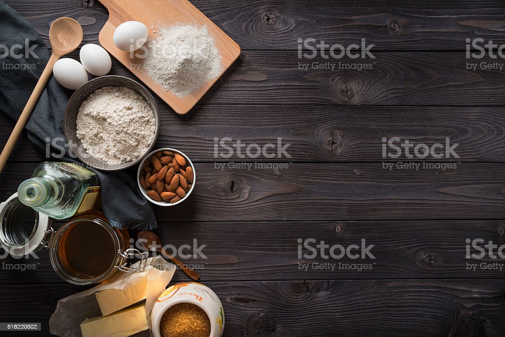 Ingredients for baking on a wooden background top view stock photo