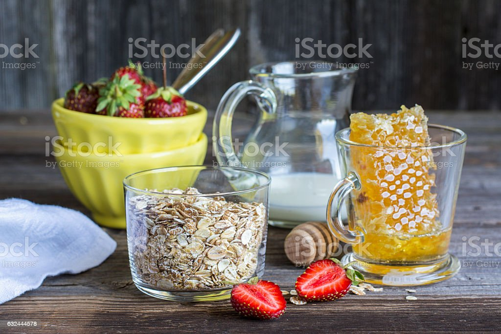 Ingredients for breakfast cereals, milk honeycomb on a dark wooden stock photo