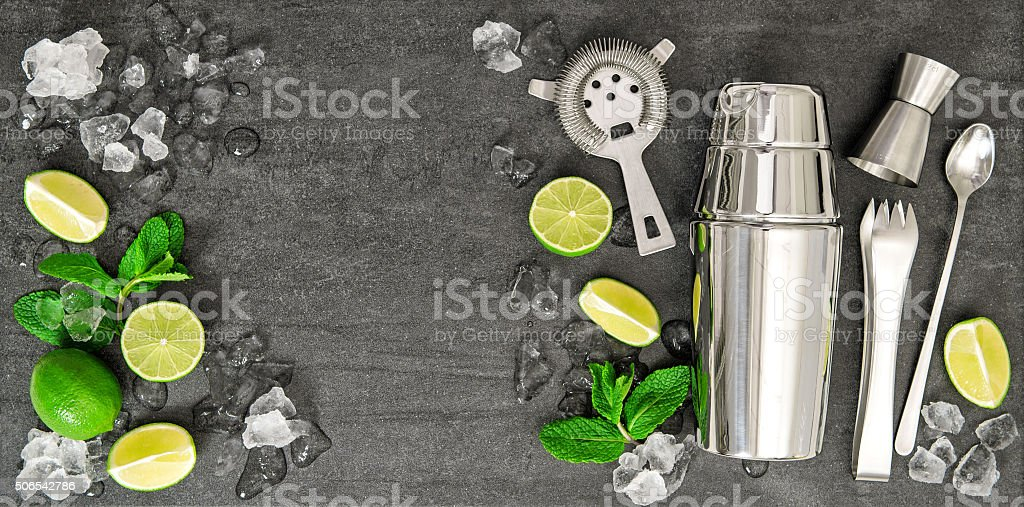 Ingredients for cocktail drink lime, mint leaves, ice stock photo