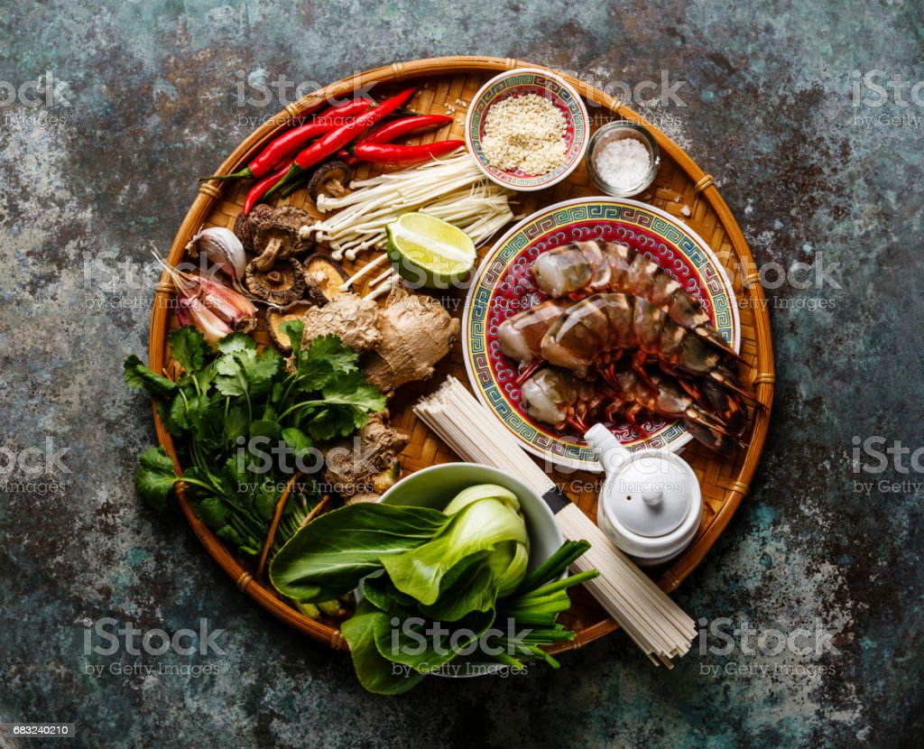 Ingredients for cooking Asian food with shrimps, noodles, mushrooms stock photo