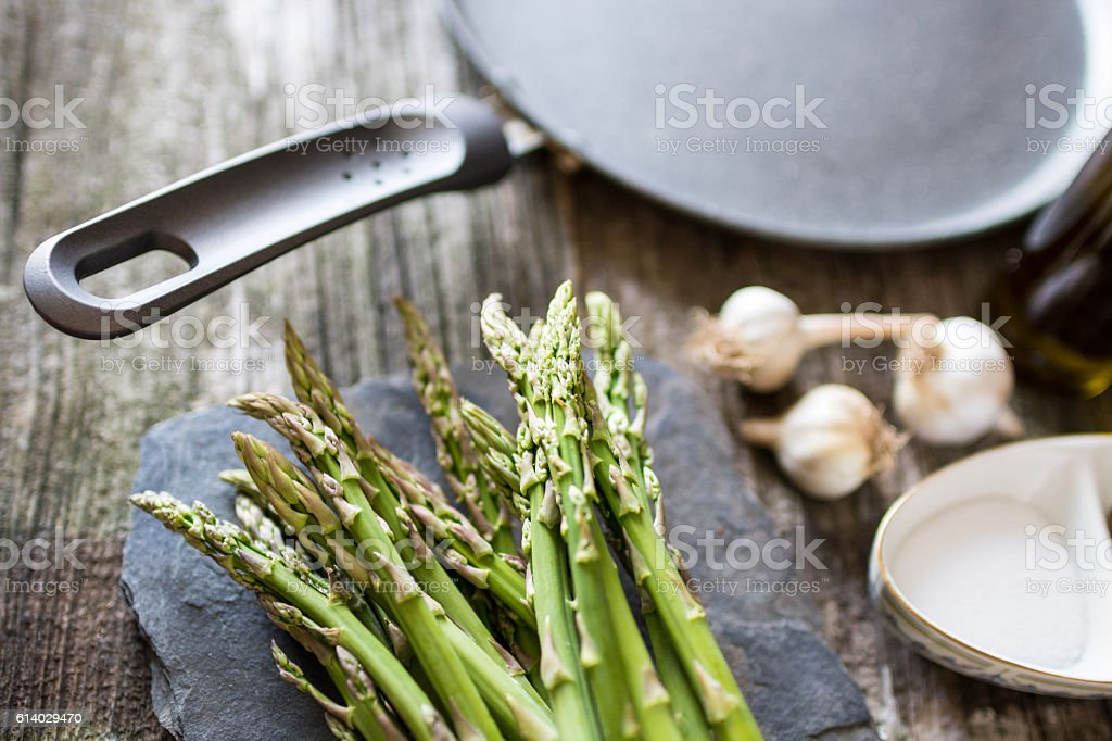 Ingredients for cooking asparagus on a wooden background, angle view stock photo