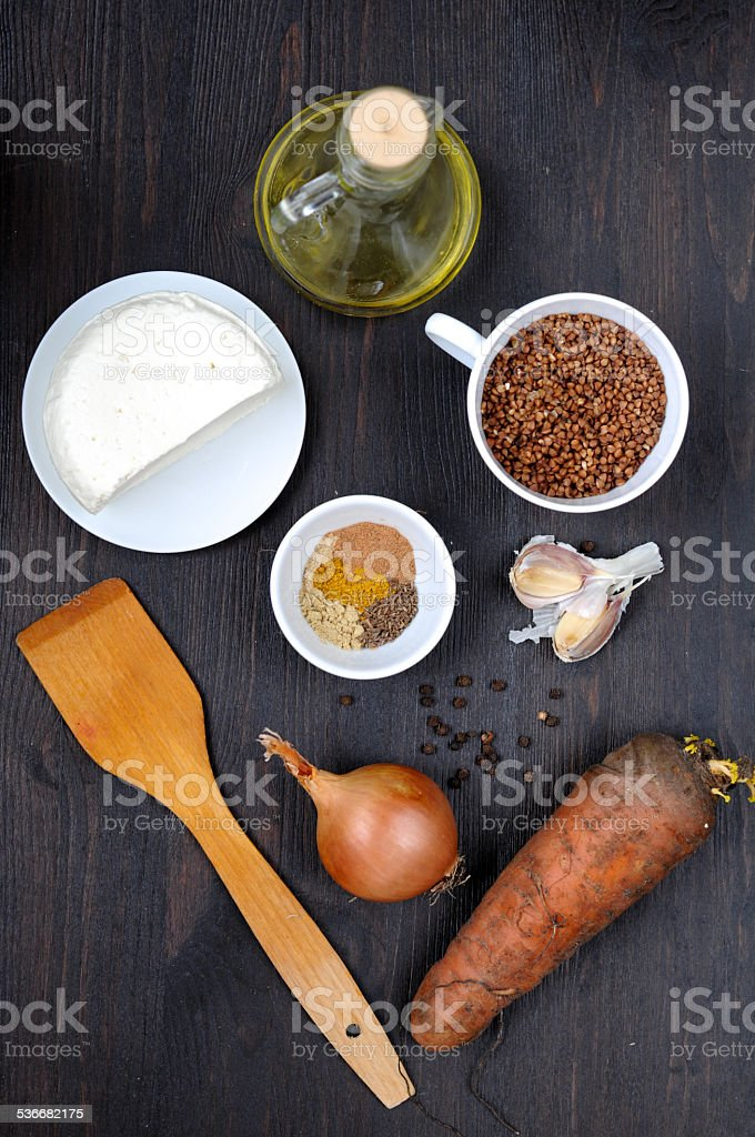 Ingredients for cooking boiled buckwheat with cheese and carrot. stock photo
