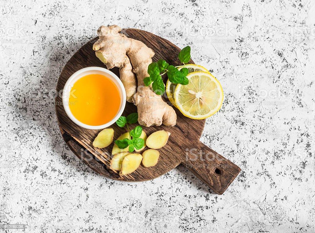 Ingredients for cooking detox drink - ginger, lemon, honey, mint. stock photo