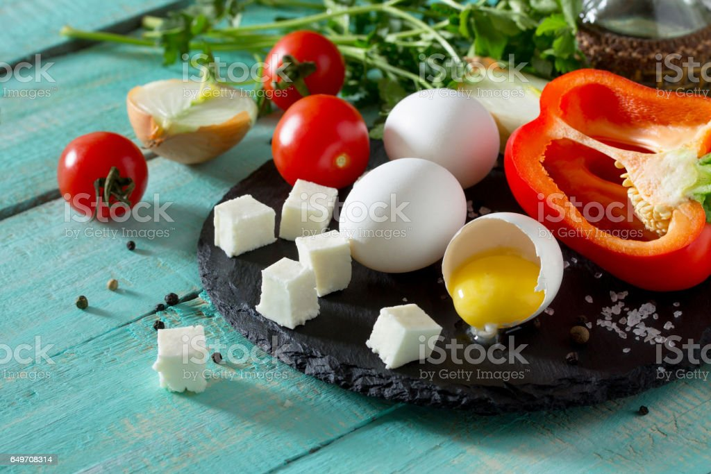 Ingredients for cooking egg omelette stuffed with red pepper and cheese. The concept of healthy nutrition and diet. Easy preparation of breakfast. stock photo