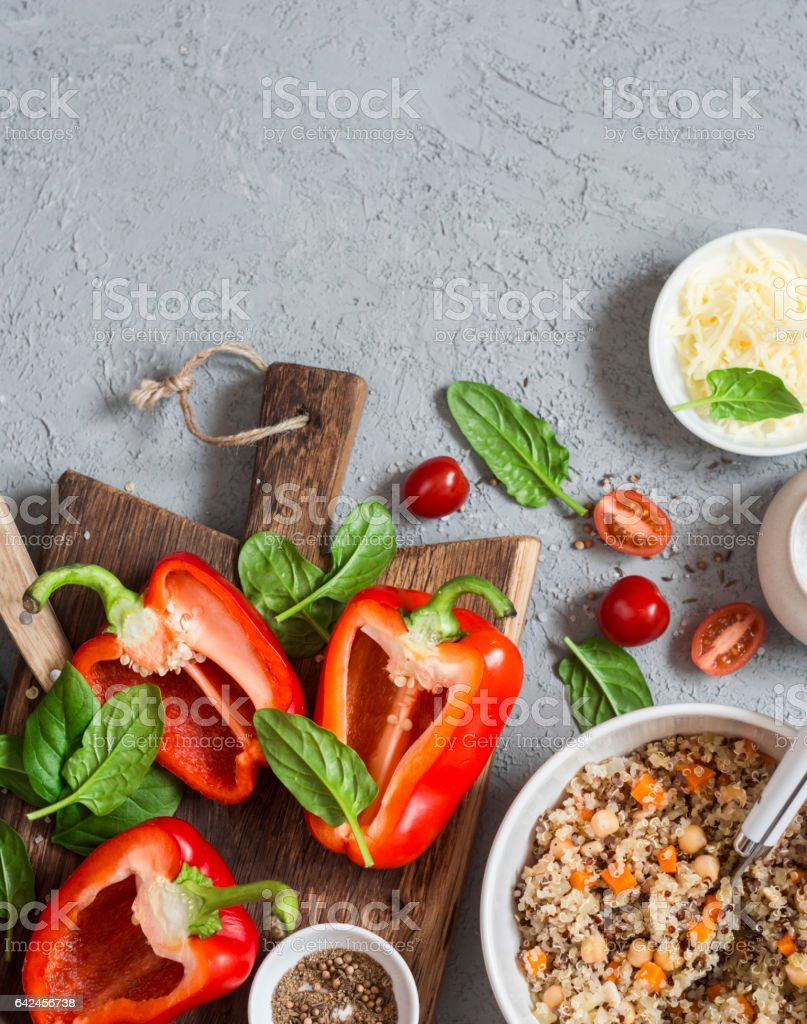 Ingredients for cooking quinoa stuffed bell peppers. Top view, flat lay. Copy space stock photo