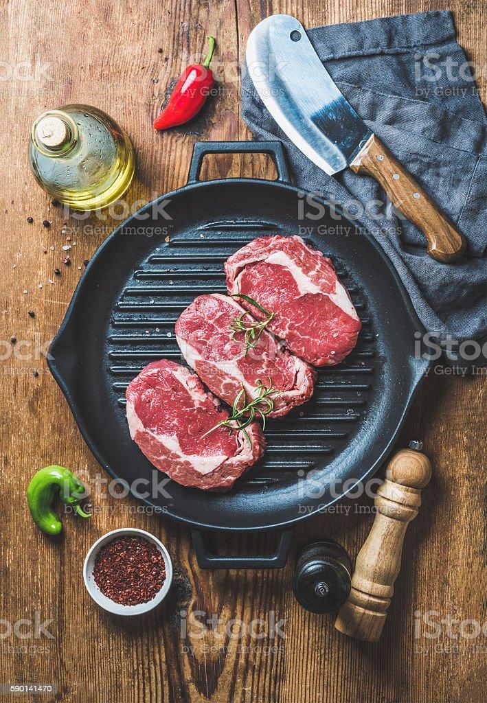 Ingredients for cooking Rib eye roast beef steak in pan stock photo