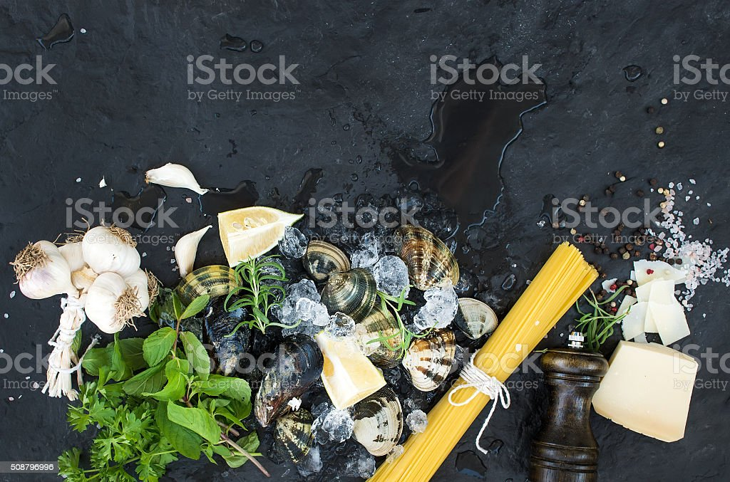 Ingredients for cooking Spaghetti vongole. Clams on chipped ice, raw stock photo