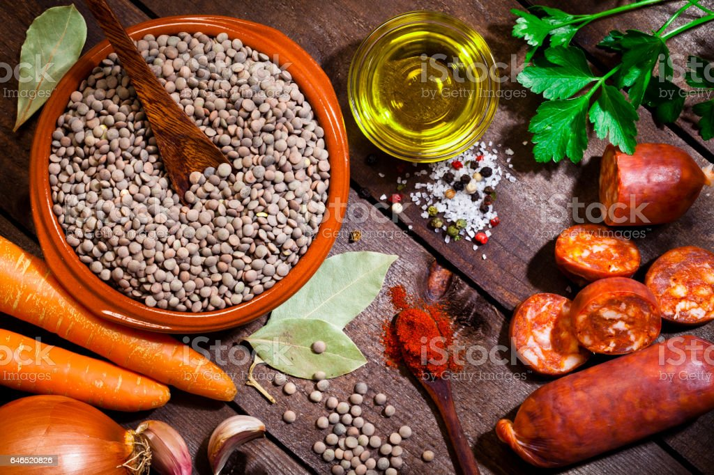 Ingredients for cooking spanish brown lentils stock photo
