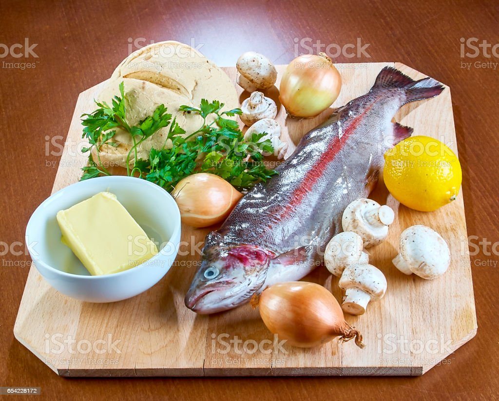 Ingredients for cooking stuffed fish mushrooms onion salad butter bread stock photo