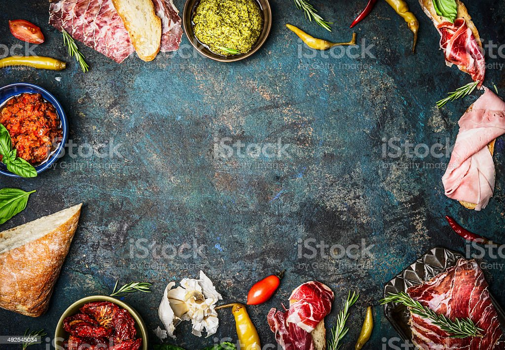 Ingredients for italian sandwich bar on rustic wooden background stock photo
