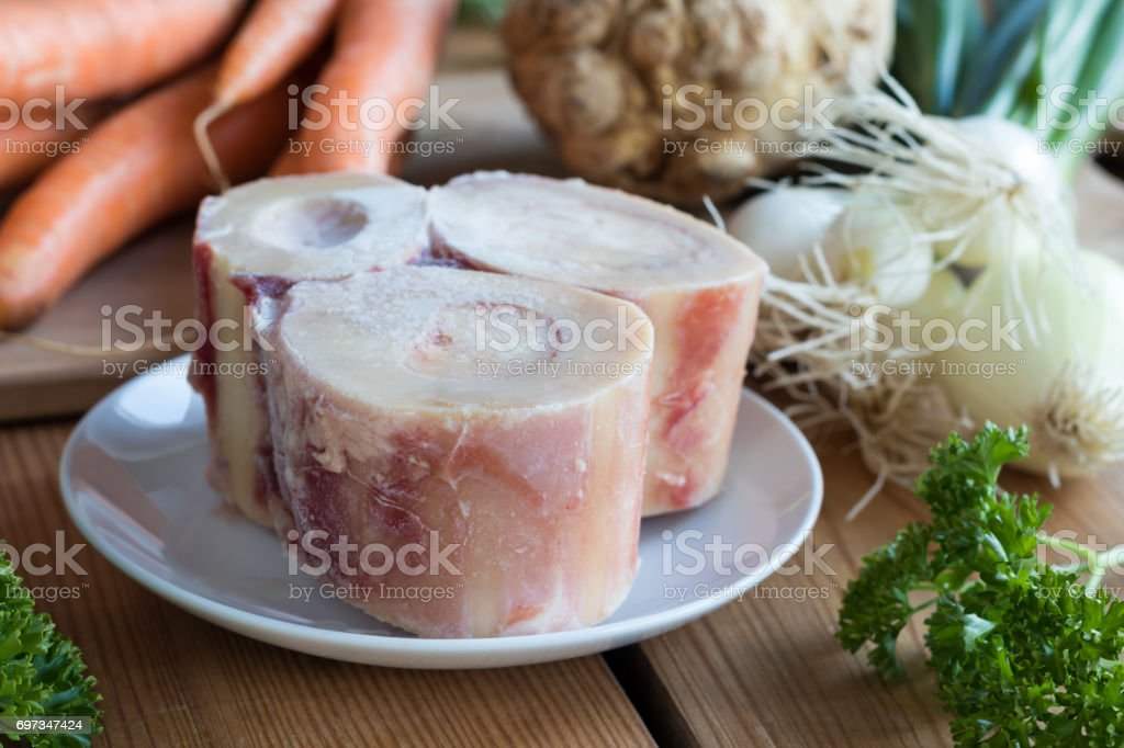 Ingredients for making a beef bone broth stock photo
