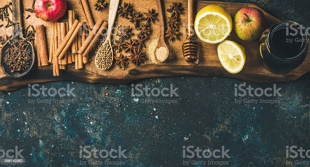 Ingredients for making mulled wine over blue painted plywood background stock photo