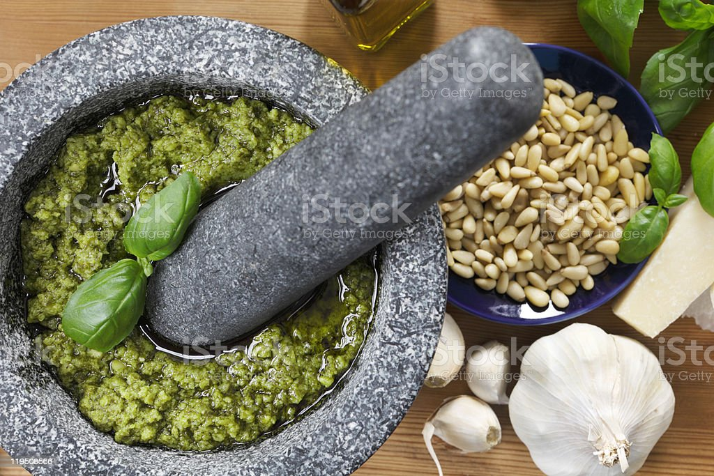 Ingredients for making pesto sauce using a Mortar and Pestle stock photo
