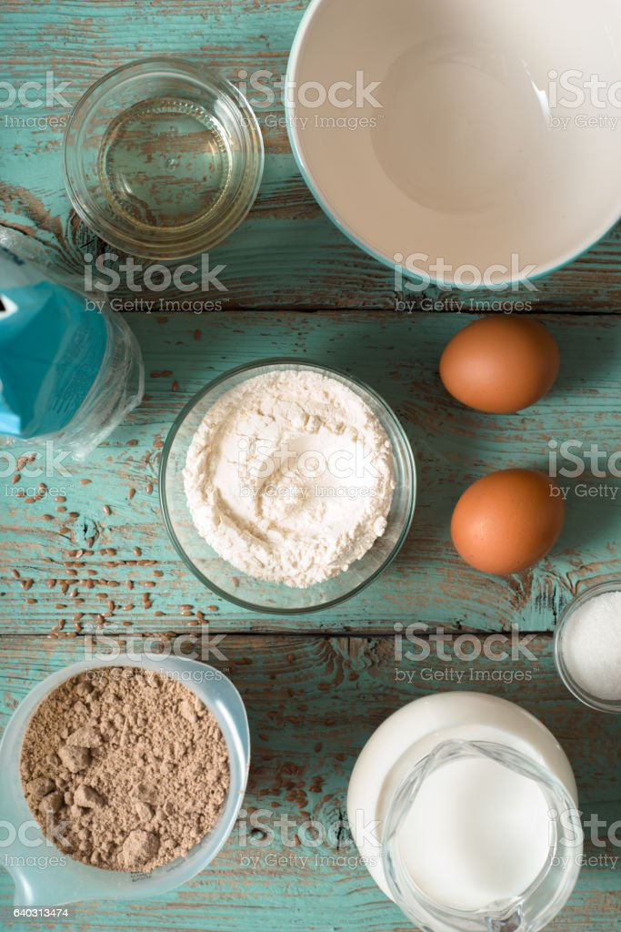 Ingredients for pancakes gluten free on blue  table top view stock photo