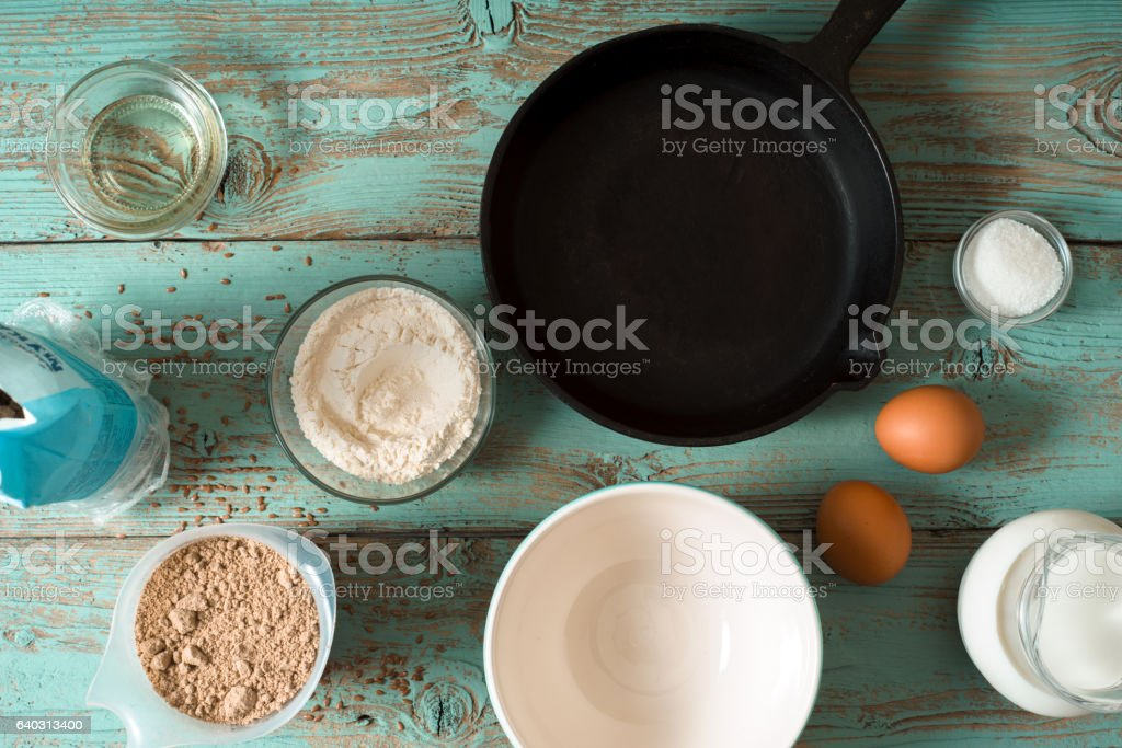 Ingredients for pancakes gluten free on blue wooden table horizontal stock photo