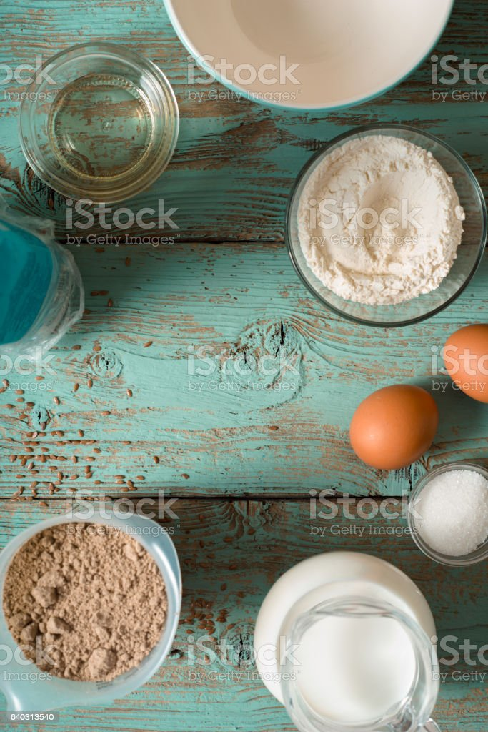 Ingredients for pancakes gluten free on the  blue wooden table stock photo
