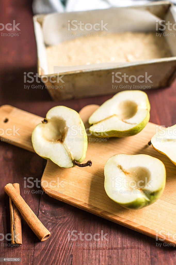 ingredients for pie pear, cinnamon, baking dish stock photo