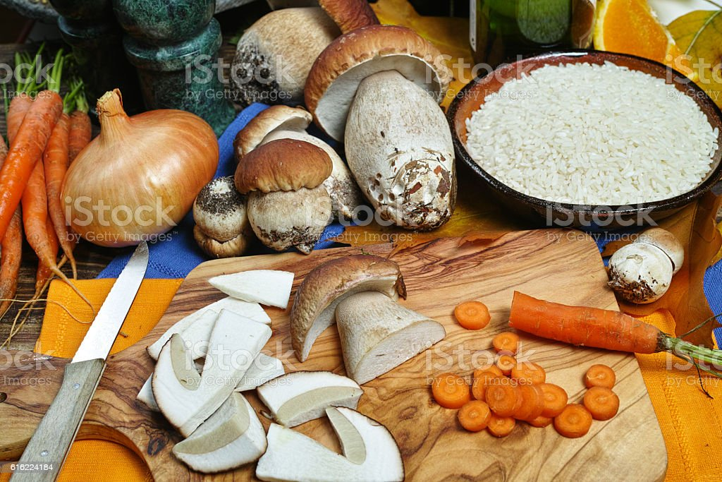 Ingredients for risotto with wild mushrooms boletus stock photo