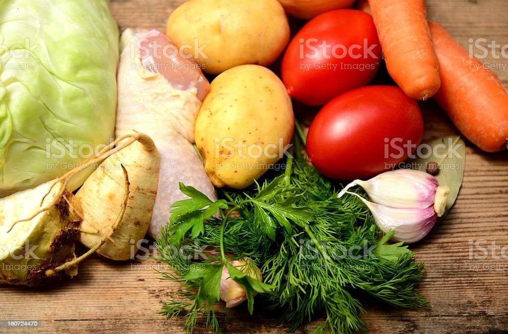 Ingredients for Russian cabbage soup schi with chicken meat royalty-free stock photo