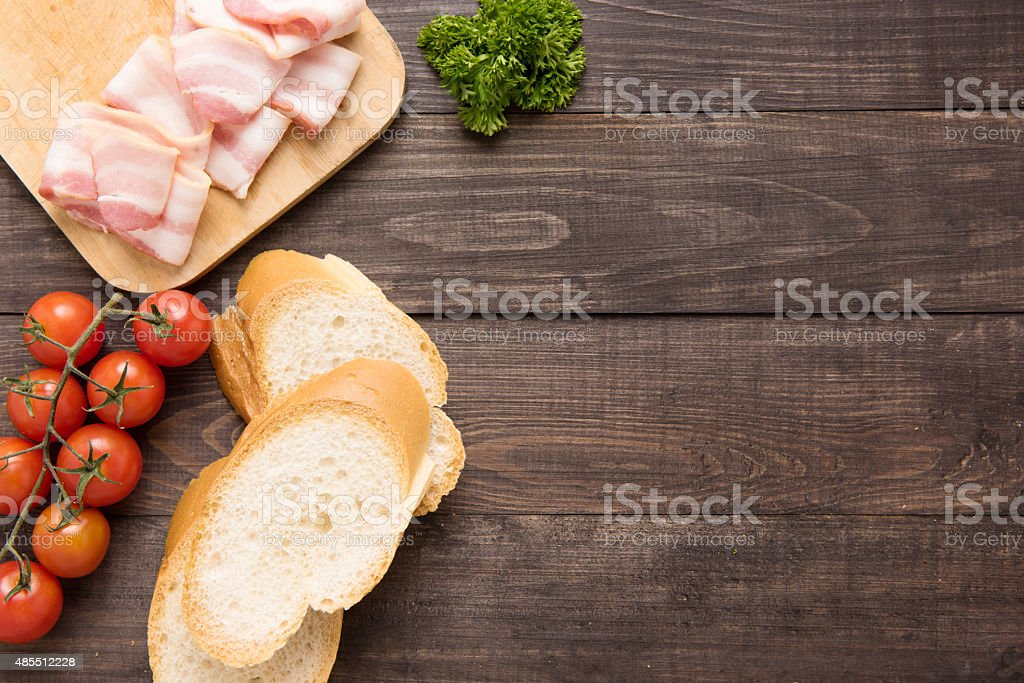 Ingredients for sandwich on wooden background stock photo