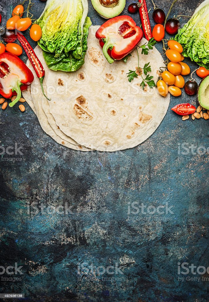 Ingredients for tacos : various fresh organic vegetables and tortillas stock photo