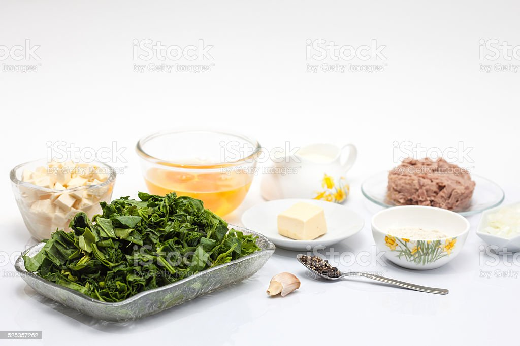 Ingredients for the filling of a spinach and tuna quiche stock photo