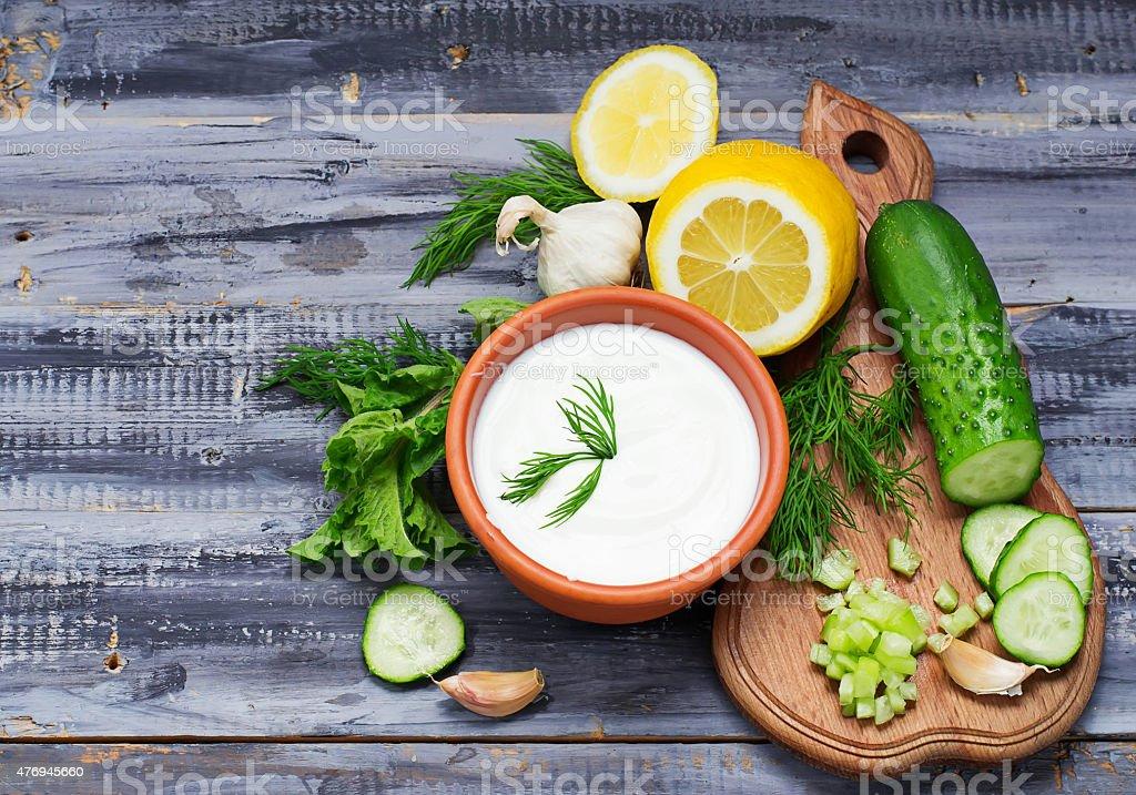 "Ingredients for tzatziki sauce "" yogurt, cucumber, mint, dill, stock photo"