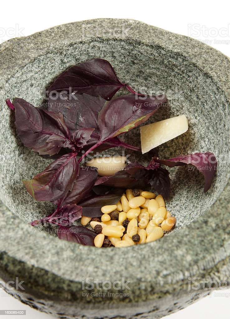 Ingredients of pesto sauce in granite mortar royalty-free stock photo