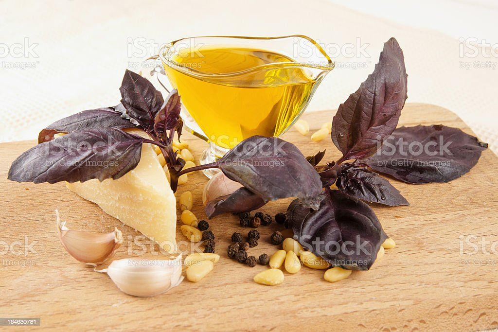 Ingredients of pesto sauce on wooden plank royalty-free stock photo