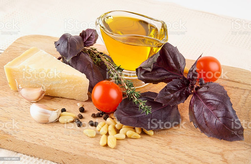 Ingredients of pesto-like sauce on wooden plank royalty-free stock photo