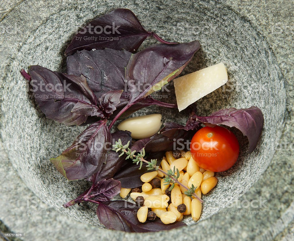 Ingredients of sauce in granite mortar royalty-free stock photo