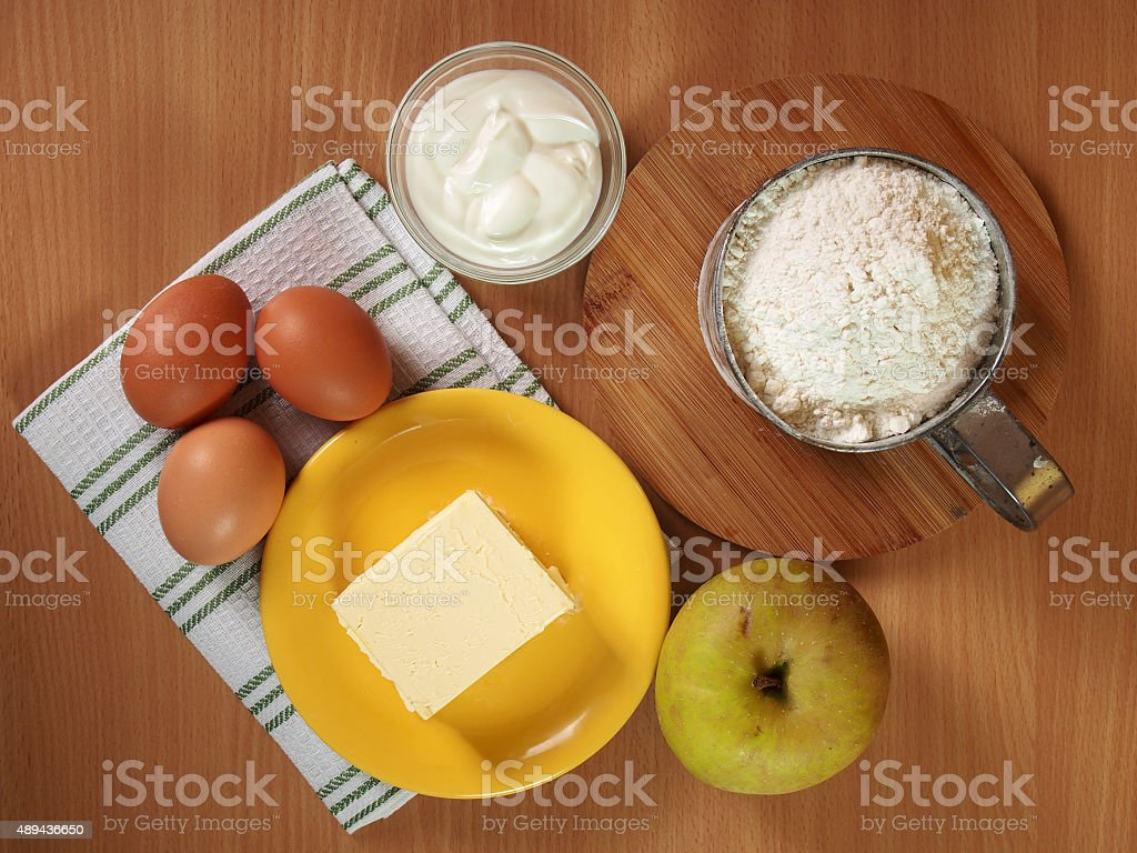Ingredients to make apple pie. Making Apple Pie Tart Series. stock photo