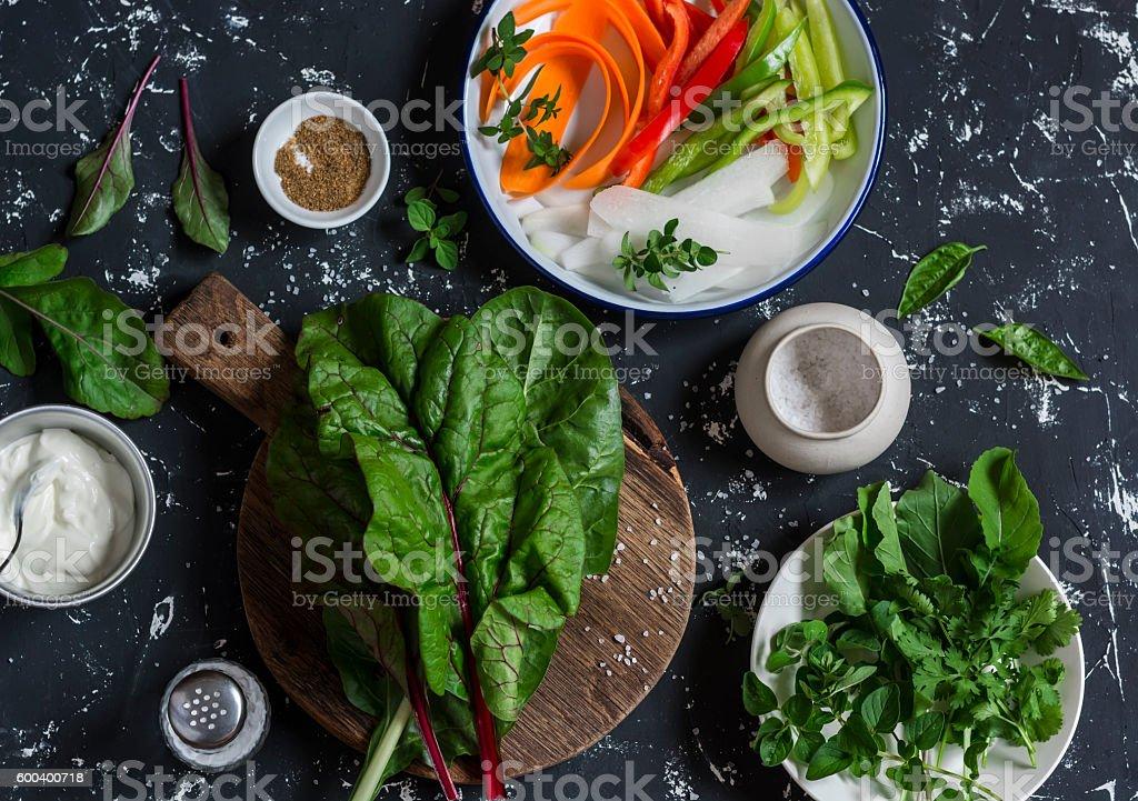 Ingredients to prepare vegetable rolls on dark background stock photo