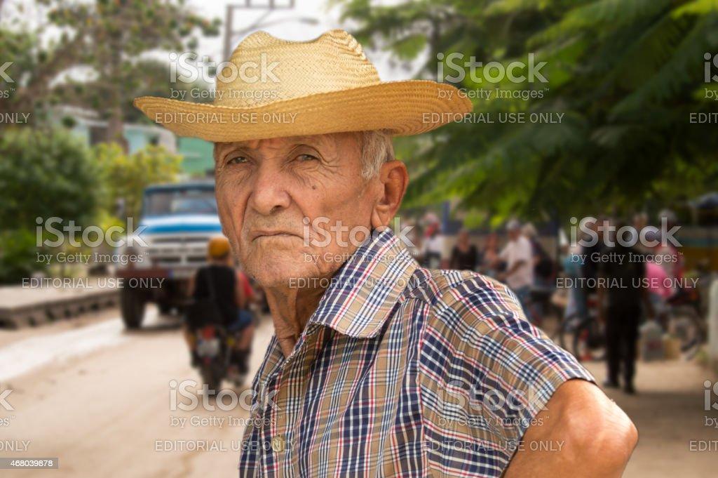 Inhabitant of Camag?ey, Cuba, waiting in the street stock photo