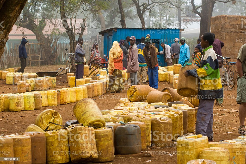 Inhabitants of Marsabit waiting to fill jerrycans with water, Kenya stock photo