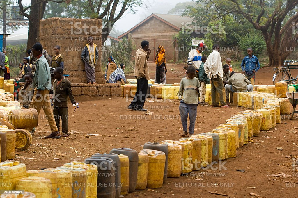 Inhabitants of Marsabit waiting to fill jerrycans with water stock photo