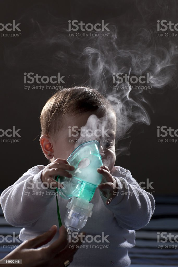 Inhalation baby therapy. stock photo