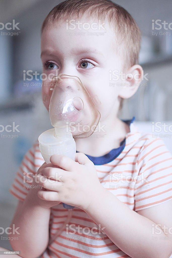 inhalation by nebulizer stock photo